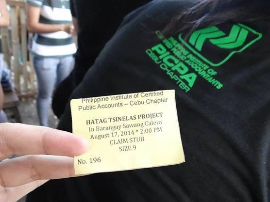 Tsinelas Distribution at Brgy. Sawang Calero on August 17, 2014 (7)